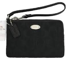 Coach Signature Wristlets - Up to 70% off at Tradesy
