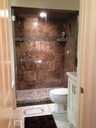 tub shower combo with glass doors. gleaming glass doors and slate make a signature shower tub combo with h