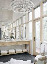 secondary baths and powder rooms can be lit more simply this gallery shows both master bath and secondary lighting ranging from clean contemporary to