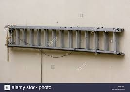 Ladder hanging on a wall