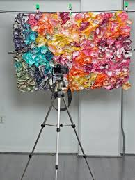 diy photo booth with tripod colorful backdrop