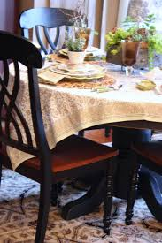 pretty scalloped rattan placemats work well with the tablecloth their soft brown hue adds a layer of organic warmth to the table