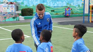 photo essay pairing soccer and poetry on a new field district  professional soccer player tommy thompson from the san jose earthquakes signs autographs for students at the