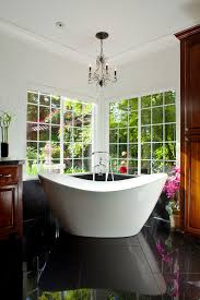 good looking soaker tub in bathroom contemporary with best bathtub next to chandelier over tub alongside black granite floor and light over tub