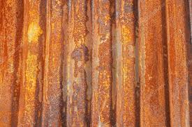 old corrugated metal sheet covered with rust photo by