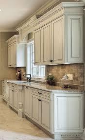 off white kitchen cabinets with dark granite countertops
