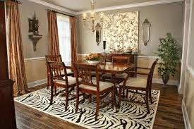 brown wooden dining set on black white zebra rug connected by brown fabric curtains on the hook and grey wall theme