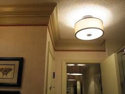 lovely semi flush mount rounded ceiling lamps as modern hallway lighting with white door trims in entryway decorating ideas
