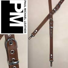 natural leather suspenders with bullet trigger snaps and double headed snake buckles