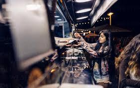 Young <b>woman</b> taking food of food stall at <b>summer</b> night <b>festival</b> ...