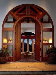 arched double front doors. Example Of A Trendy Double Front Door Design In Denver With Medium Wood Arched Doors