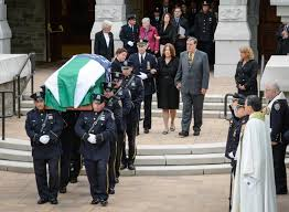 bill bratton reads late nypd officer s essay at funeral ny daily  michael g williams and joann johanson williams parents of nypd police officer michael c williams walk behind their son s casket at his funeral in