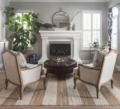 tan striped jute rug with bergere chairs