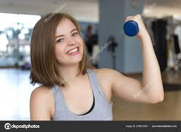 Lifting Light Weights Smiling Young Caucasian Woman Girl Doing Workout Light