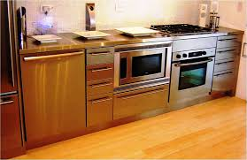 small brush metal kitchen cabinet mozaic tile backsplash built in single convection wall oven self cleaning free standing gas range in smudge proof