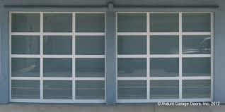 two contempora ry full view glass garage doors with white powder coated aluminum frames and white laminated glass 9 x7