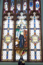 the window featuring saint alphonsus rodriguez who in the 1500s served as the doorkeeper at