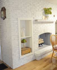shelves inserted into a whitewashed brick fireplace
