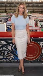 picture perfect the 33 year old donned a pastel blue jumper with a white leather pencil s