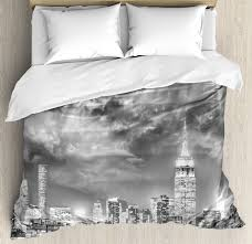 urban duvet cover set dramatic new york city skyline sun beams clouds skysers monochrome landscape decorative bedding set with pillow shams