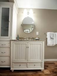 oval mirrors for bathroom. Rustic Bathroom Vanity With Oval Mirror Using Brushed Nickel Bracket Under Wall Mounted Lights, Elegant Mirrors For S