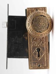 vernacular eastlake door knob set with plate lock