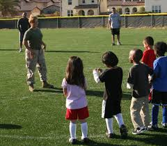 a female marine the semi normal day to day life of a female sgt denise serrano the combat camera photography chief headquarters squadron lines up a soccer team of five year olds for a kick at practice on