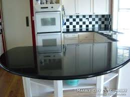 absolute black granite bay area countertops with white cabinets