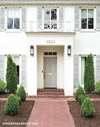 white shutters on house white brick painted home with gray front door white house black shutters yellow door