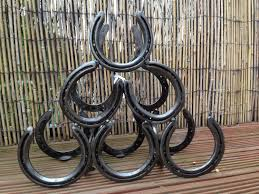 things to make with horseshoes. horse shoe wine rack - £55 at etsy things to make with horseshoes e