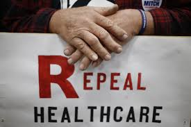 affordable care act tag newshour a kentucky voter holds a repeal healthcare sign at a rally for mitch mcconnell