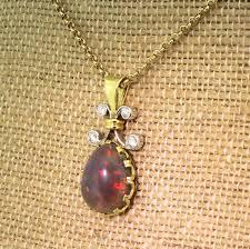 mid century 5 73 carat black opal diamond pendant circa 1965