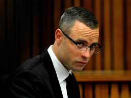 EPA/THOBILE MATHONSISouth African Paralympic athlete Oscar Pistorius in the dock at the high court in Pretoria, South Africa, 05 May 2014. - oscar_pistorius-3