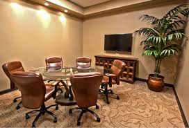 classic espresso conference room with round glass conference table and leatherhead swivel chair also lcd tv