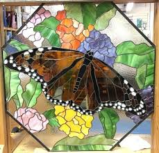 make a statement with glass in the garden either a free formed piece or garden stake