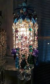 colorful chandelier lighting. a fabulous little pendant chandelier in pretty peacock colors of blue aqua purple and green i do love coloured chandeliers they throw lovely shards colorful lighting