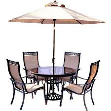 monaco 5 piece outdoor dining set with round glass top table and contoured sling