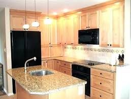 kitchens with maple cabinets colonial white granite