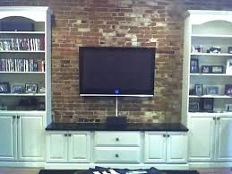mount on brick fireplace sterling home theater custom installations fireplaces wall with hang tv hide cables