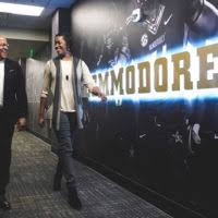 vice chancellor for athletics and university affairs and athletics director malcolm turner walks with senior ociate vanderbilt weles malcolm turner