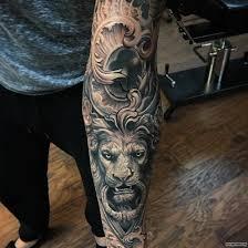 полный значение татуировки лев на левой руке плече ноге груди
