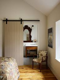 lovely farmhouse style bathroom with a sliding barn door design moger mehrhof architects