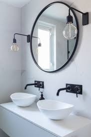 Image result for bathroom sink doesn t line up with light fixture