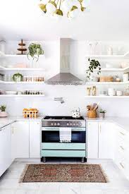 open oven in kitchen. baby blue oven and open shelving in kitchen