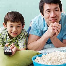 kids watching tv and eating. kids watching tv and eating