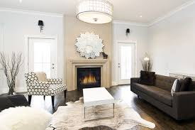 cow hide rugs living room eclectic with animal hide arm chair carved stone coffee table drum animal hide rugs home office traditional