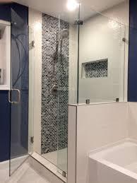 frameless corner shower enclosure with return panel over half wall