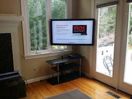tv mounted in corner with full motion mount