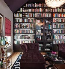 furnitures small library with midcentury sofa near grey bookcase with glass door home library decor