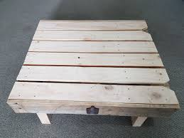 my first attempt at making pallet furniture a coffee table with bottle opener